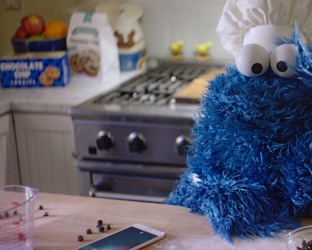 Cookie Monster uses hands-free Siri to countdown until his cookies are ready, but she isn't contributing much to his patience.
