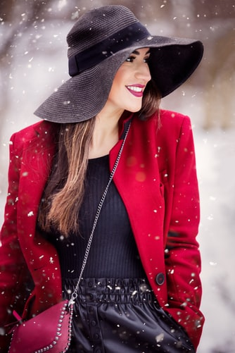 Woman smiling with great skin in winter