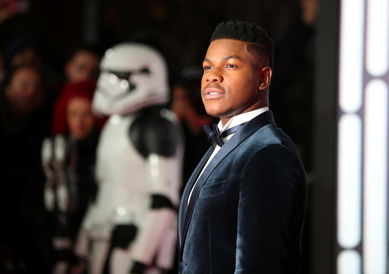 "John Boyega playing Finn in ""Star Wars"""