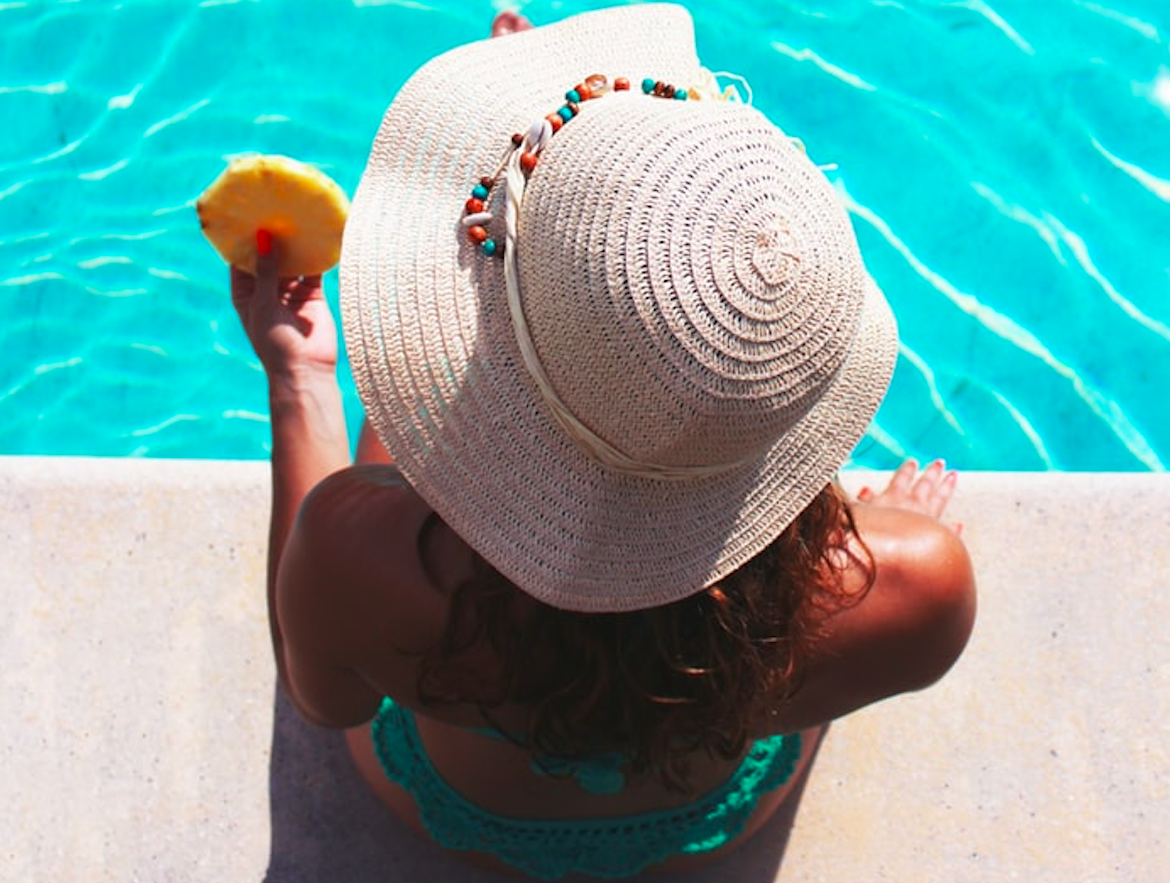 Woman Chilling Beside the Pool