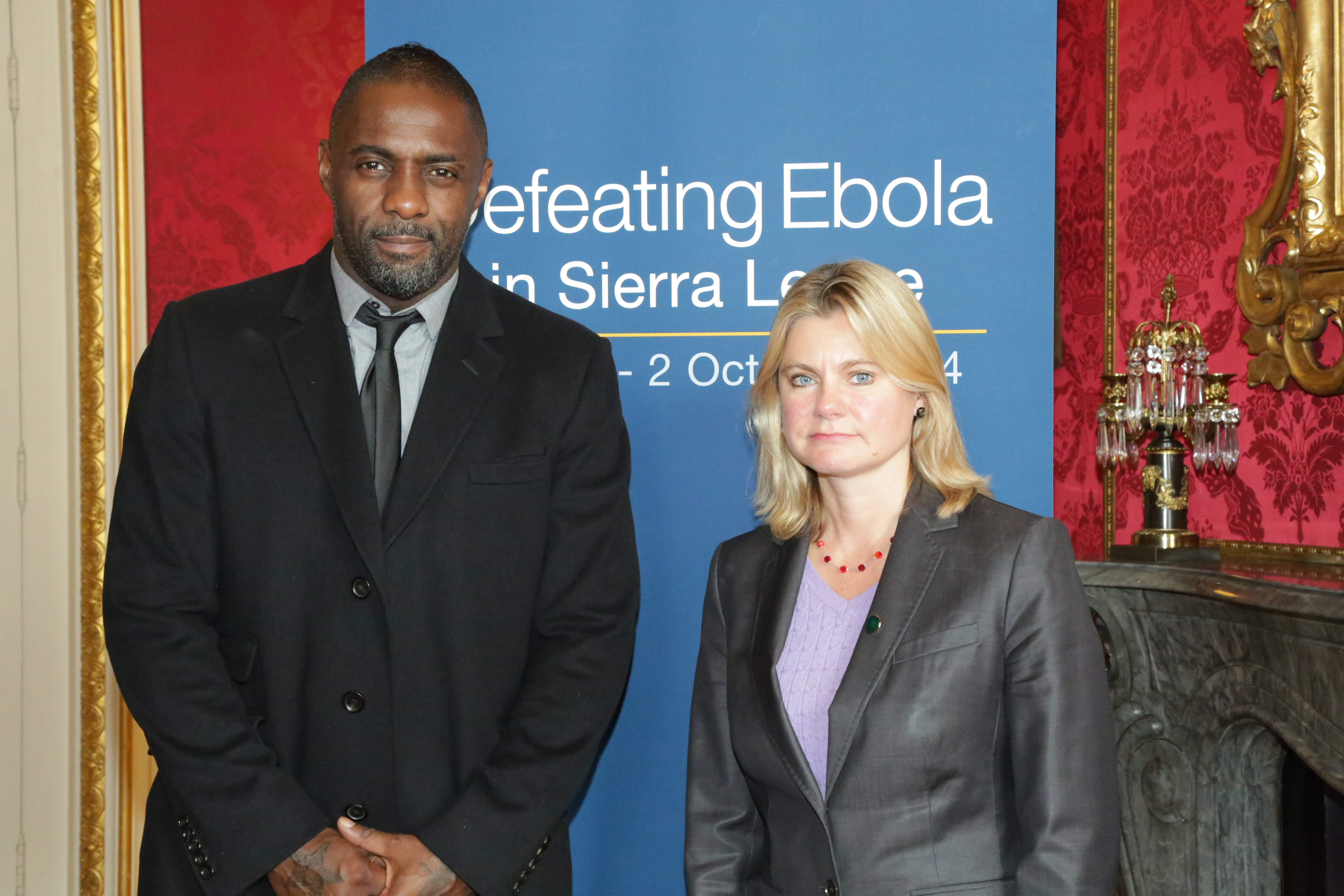 Idris Elba and Secretary of State Justine Greening arrive at the 'Defeating Ebola' conference