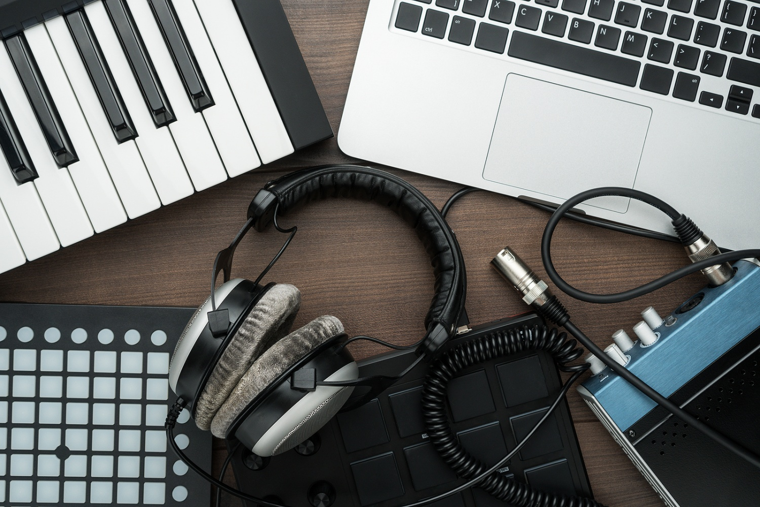 top view of home music studio. music production equipment on the table. music making tools on wooden background.