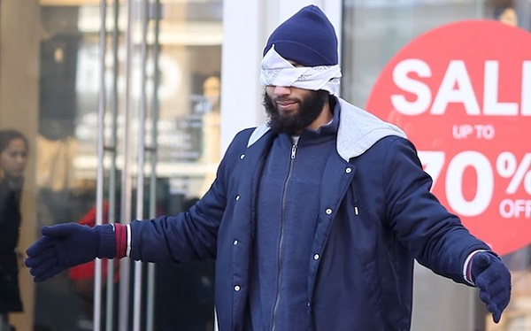 Blindfolded man in the streets of Paris after terror attacks
